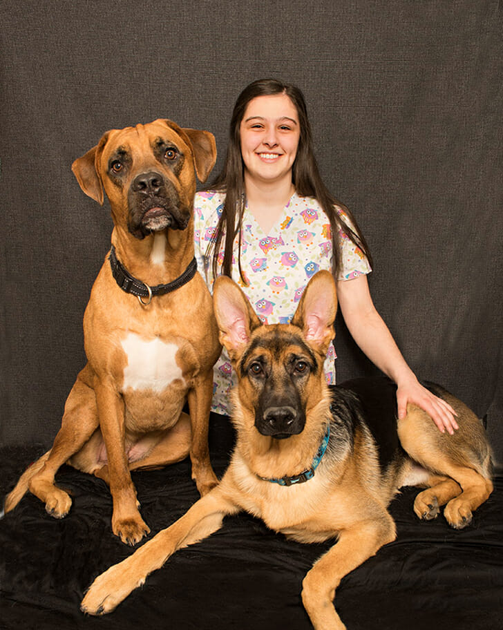 Carly Logan with two dogs