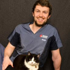 Dr. Daragh Clifford with a cat