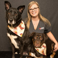 Elisha Chambers with two dogs
